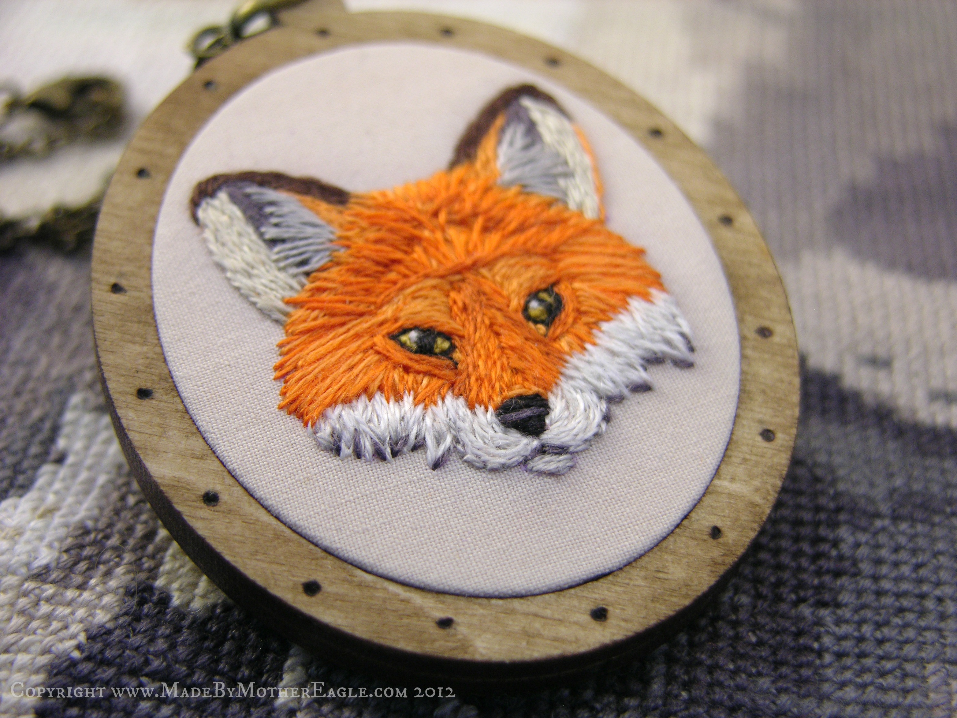 Hand Embroidered Pendant featuring the face of a fox