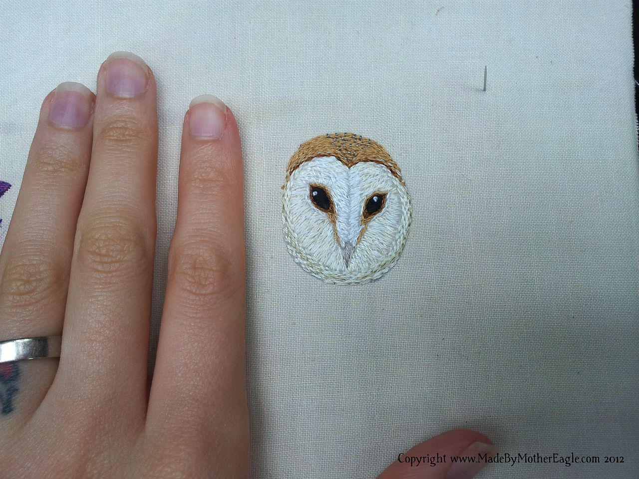 Iamge showing scale of Barn Owl Embroidery  in relation to human hand