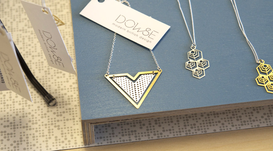 Two of Susannah Dowse tiny geometry necklaces