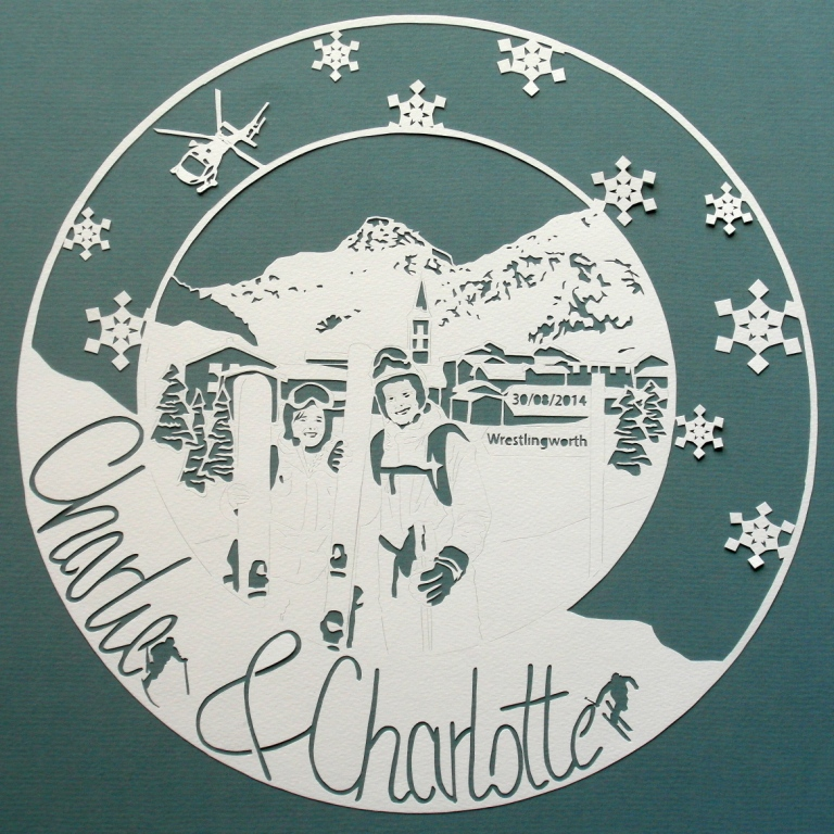Papercut showing wedding couple on a skiing holiday