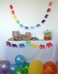 Rainbow Party Table with garlands, balloons and gifts
