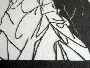 Closeup detail of the papercut showing the ruffled fabric of the wedding dress