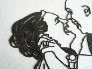 Closeup of papercut showing bride's hair.