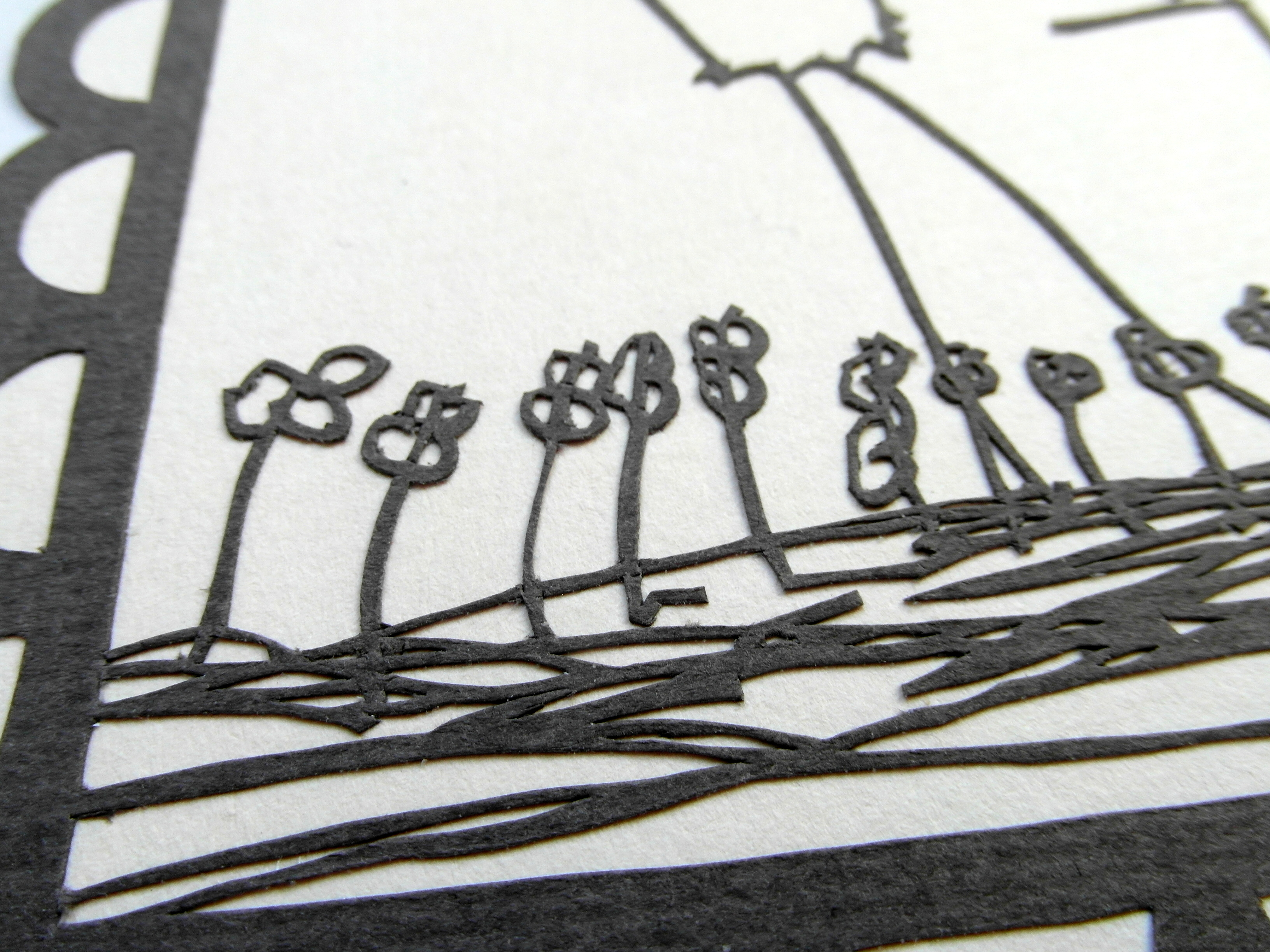 Closeup of child's flower drawing as a papercut