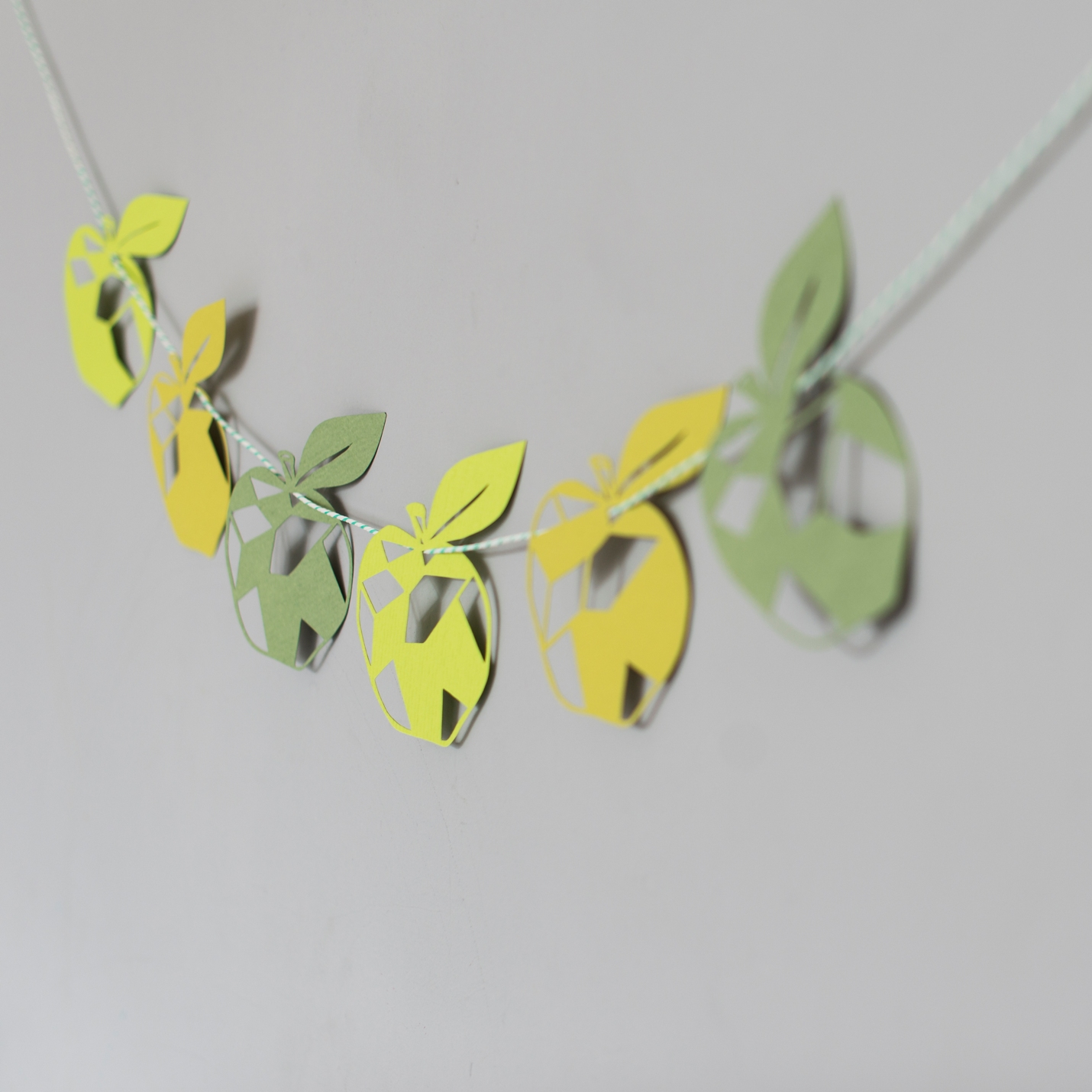 Paper Garland featuring green geometric shaped apples