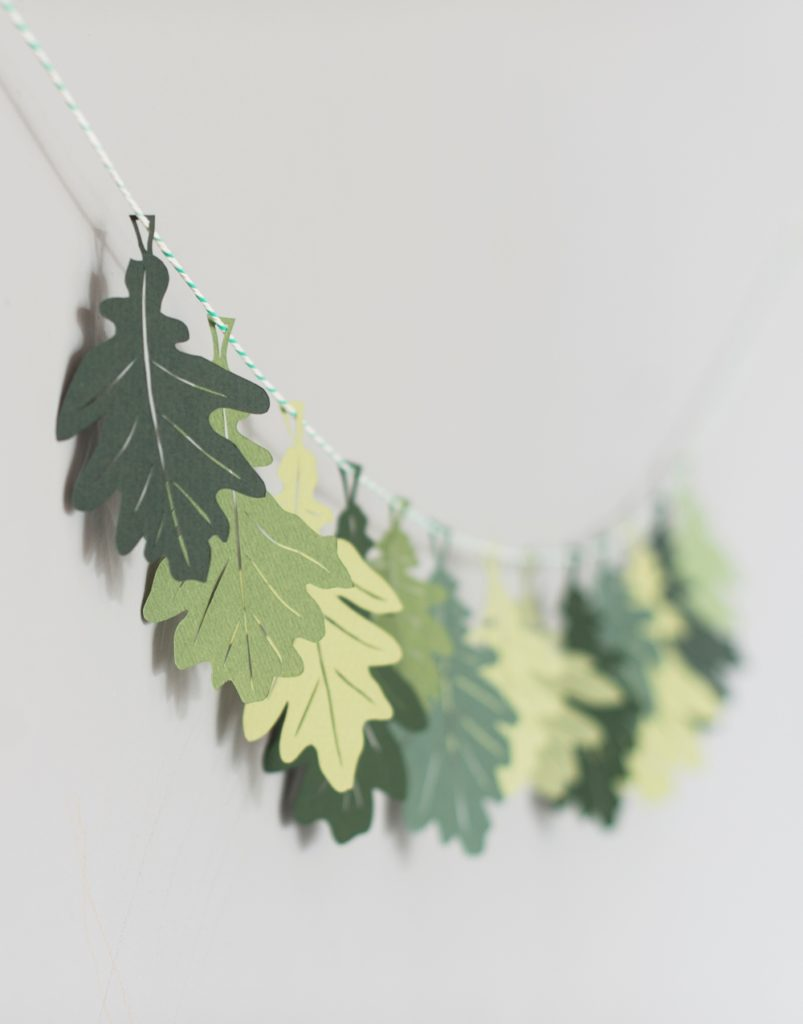 Oak Leaf garland featuring paper leaves in various shades of green