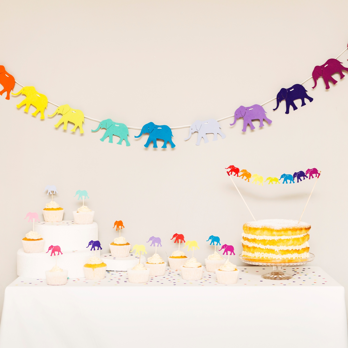 Rainbow Elephant Paper Garland with cake toppers and cake bunting