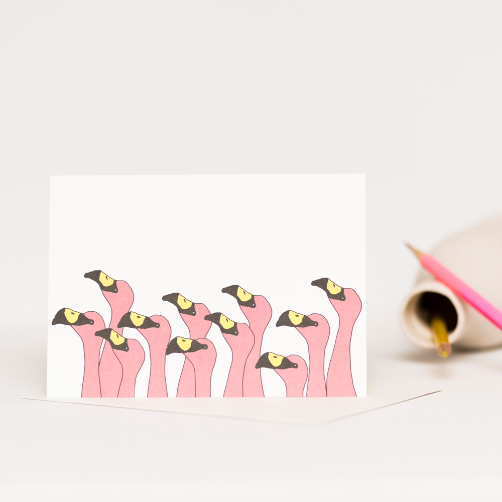 Card featuring a flock of flamingos