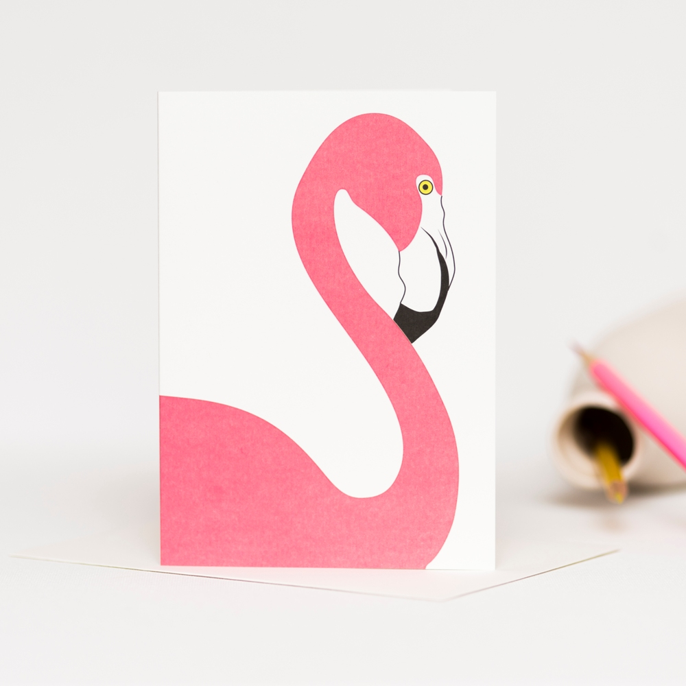 Blank greetings card featuring a pink flamingo