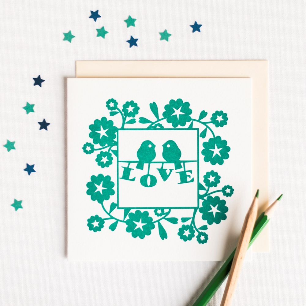 Letterpress Card featuring a pair of green love birds