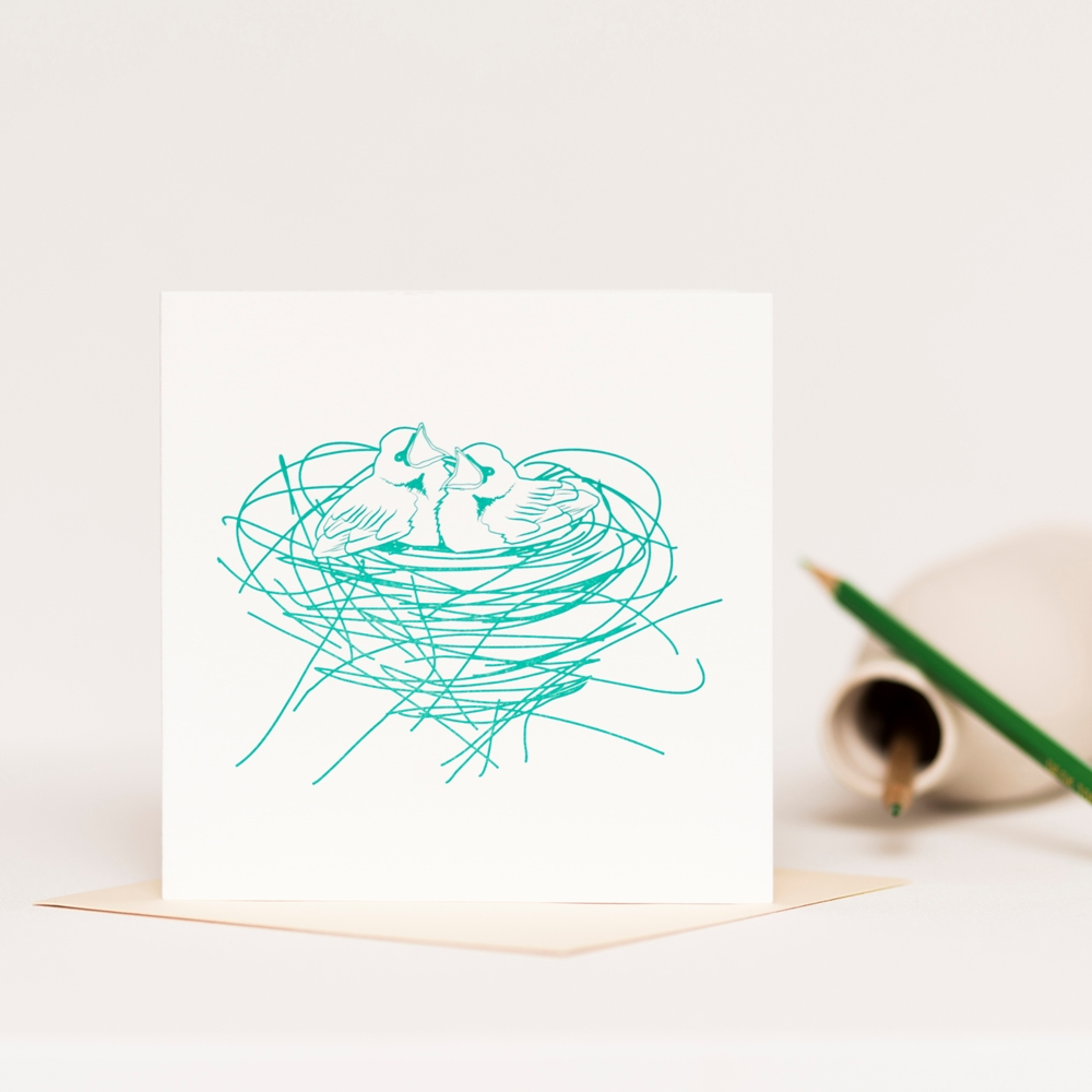 Letterpress greetings card printed in aqua green featuring two chicks in a nest